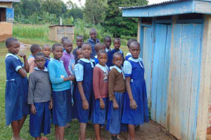 The Water Project: Kabinjari Primary School -  Girls In Line For The Latrines