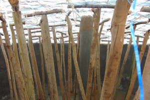 The Water Project: Kosiage Primary School -  Temporary Wooden Support Poles Inside Tank