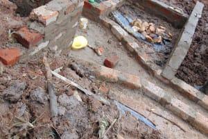 The Water Project: Jivovoli Community, Magumba Spring -  Walls Take Shape