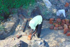 The Water Project: Buyangu Community, Mukhola Spring -  Bricklaying On The Foundation