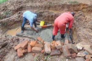 The Water Project: Bumira Community, Imbwaga Spring -  Bricklaying Begins Over Foundation