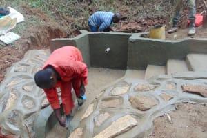 The Water Project: Kisasi Community, Edward Sabwa Spring -  Rub Wall Construction