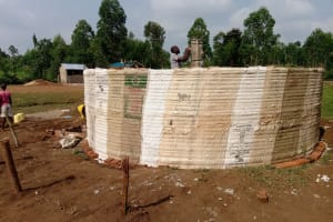 The Water Project: Mulwanda Mixed Primary School -  Artisan Secures Central Support Pillar