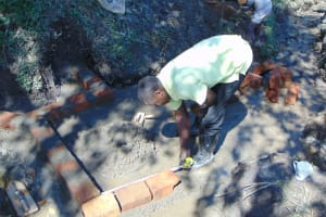 The Water Project: Buyangu Community, Mukhola Spring -  Measuring Early Brick Work