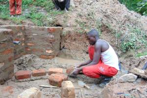 The Water Project: Kimarani Community, Kipsiro Spring -  Brick Work Continues