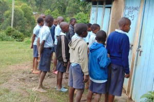 The Water Project: Kabinjari Primary School -  Boys In Line For The Latrines