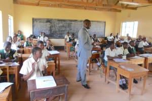 The Water Project: Friends School Manguliro Secondary -  Head Teacher Addresses A Biology Class