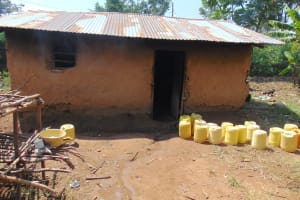The Water Project: Jimarani Primary School -  Water Containers Outside Kitchen