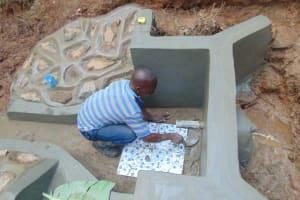 The Water Project: Kisasi Community, Edward Sabwa Spring -  Tile Setting