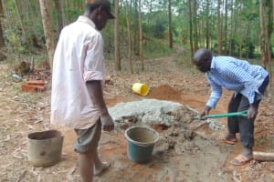 The Water Project: Shivembe Community, Murumbi Spring -  Mixing Cement