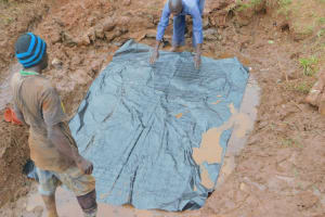 The Water Project: Busichula Community, Marko Spring -  Laying The Spring Foundation