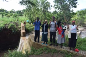 The Water Project: Utuneni Community B -  Celebrating At The Completed Dam