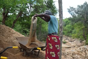 The Water Project: Kaketi Community -  Mixing Cement