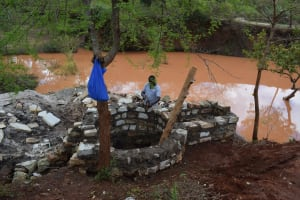 The Water Project: Utuneni Community C -  Water Held By Dam Next To Well