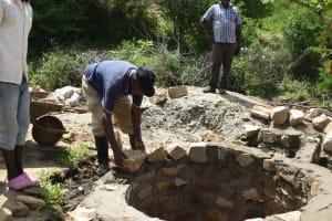 The Water Project: Kaketi Community A -  Laying Bricks