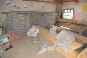 The Water Project: AIC Mbao Primary School -  Cement Bags And Construction Materials Stored In A Classroom