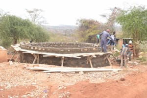 The Water Project: AIC Mbao Primary School -  Working On The Tank Wall