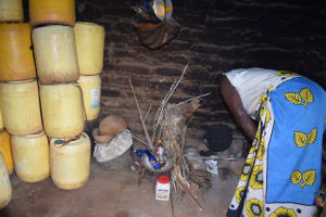 The Water Project: Kathamba ngii Community C -  Cooking In Kitchen