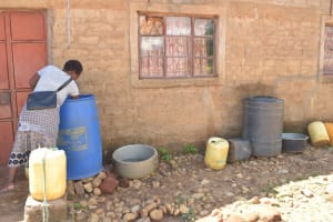 The Water Project: Syonzale Community -  Collecting Water From Storage Container