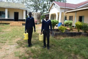 The Water Project: Mutulani Secondary School -  Students Carrying Water
