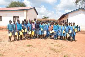 The Water Project: Kamuwongo Primary School -  Students Holding The Water Containers They Bring From Home