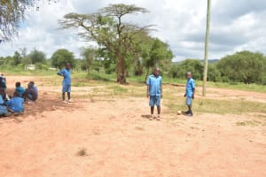 The Water Project: Kamuwongo Primary School -  Students Outside Hanging Out