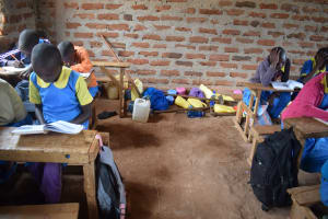 The Water Project: Kamuwongo Primary School -  Water Containers In The Back Of Class