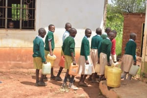 The Water Project: Mung'alu Primary School -  Students Carrying Water