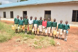 The Water Project: Mung'alu Primary School -  Students Holding Water Containers
