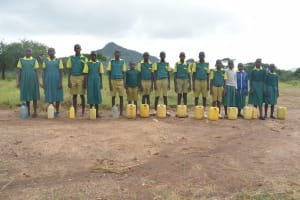 The Water Project: Ndithi Primary School -  Students And Their Water Containers
