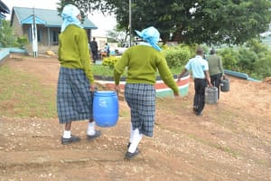 The Water Project: Mutwaathi Secondary School -  Carrying Water