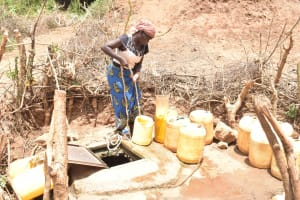 The Water Project: Mutwaathi Secondary School -  Collecting Water From The Well