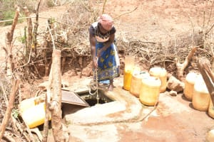 The Water Project: Mutwaathi Secondary School -  Hauling Water From The Open Well