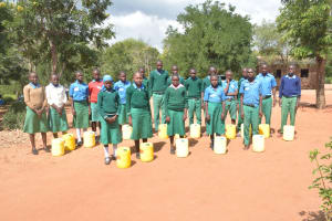 The Water Project: Kalatine Primary School -  Students Holding Water Containers