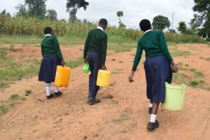 The Water Project: Mukuku Mixed Secondary School -  Carrying Water