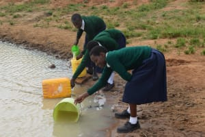 The Water Project: Mukuku Mixed Secondary School -  Filling Up Containers With Water