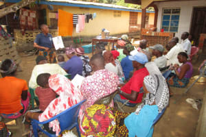 The Water Project: Transmitter, #14 Port Loko Road -  Community Members Listen During The Training