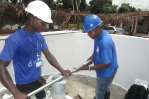 The Water Project: Transmitter, #14 Port Loko Road -  Screwing Cylinder To Rising Main