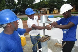 The Water Project: Transmitter, #14 Port Loko Road -  Screwing Pump Tank To The Base