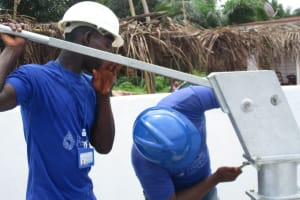 The Water Project: Transmitter, #14 Port Loko Road -  Screwing The Pump Head