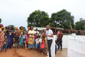 The Water Project: Transmitter, #14 Port Loko Road -  Staff Member Discusses The New Well With Community Members