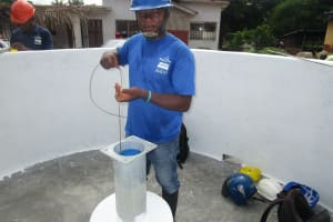 The Water Project: Transmitter, #14 Port Loko Road -  Taking Total Depth And Static Level For Chlorination
