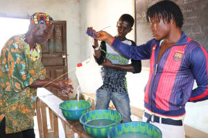 The Water Project: Lokomasama, Musiya, Nelson Mandela Secondary School -  Tippy Tap Handwashing Demonstration