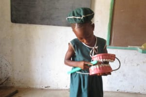 The Water Project: Lokomasama, Bompa, DEC Bompa Primary School -  Student Demonstrates Toothbrushing