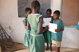 The Water Project: Lokomasama, Bompa, DEC Bompa Primary School -  Students Hold Training Materials During An Activity