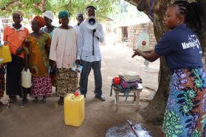 The Water Project: Lungi, Yaliba Village -  Facilitator Teaches About Handwashing