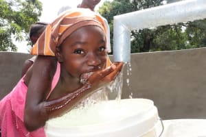 The Water Project: Lungi, Yaliba Village -  Girl Drinks From The Well