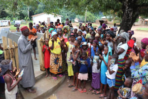 The Water Project: Lungi, Yaliba Village -  Village Imam Leads Prayer Over The Well