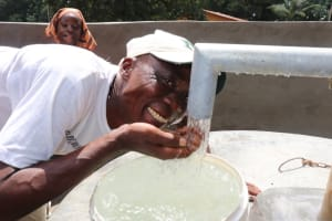 The Water Project: Lungi, Yaliba Village -  Village Headman Drinks From The Well