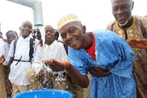 The Water Project: Lungi, Komkanda Memorial Secondary School -  Town Chief Rejoicing At The New Well